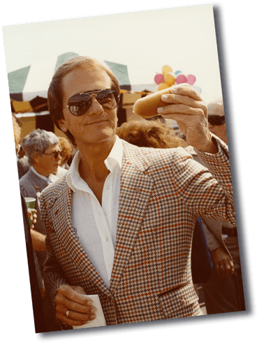 Pat Boone eating a Hoffy Hot Dog