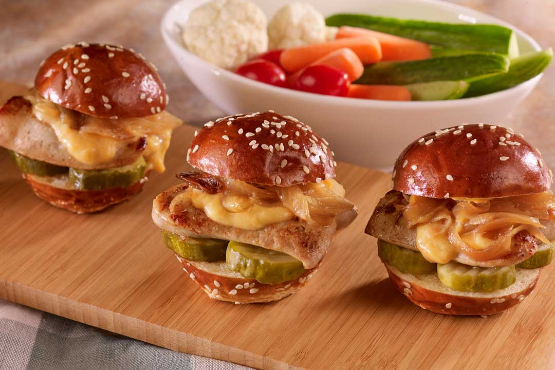 Hoffy Bratwurst Sliders with Pub Cheese and Braised Onions